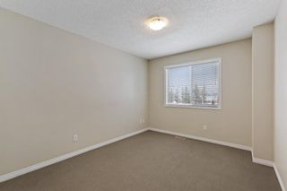 Photo 16: 94 Everridge Gardens SW in Calgary: Evergreen Row/Townhouse for sale : MLS®# A1069502