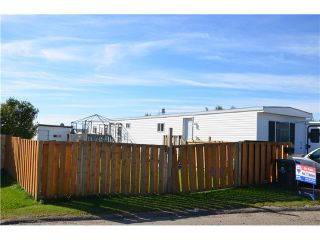"""Main Photo: 48 8420 N ALASKA Road in Fort St. John: Fort St. John - City SE Manufactured Home for sale in """"PEACE COUNTRY MHP"""" (Fort St. John (Zone 60))  : MLS®# N230672"""