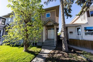 Photo 2: 415 52 Avenue SW in Calgary: Windsor Park Semi Detached for sale : MLS®# A1112515