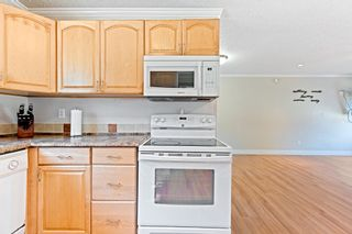 """Photo 8: 20572 43 Avenue in Langley: Brookswood Langley House for sale in """"BROOKSWOOD"""" : MLS®# R2624418"""