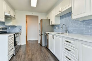 """Photo 15: 403 3070 GUILDFORD Way in Coquitlam: North Coquitlam Condo for sale in """"LAKESIDE TERRACE"""" : MLS®# R2565386"""