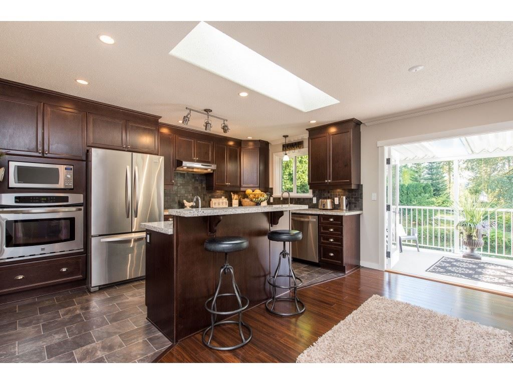 Space for an eating area off kitchen. Beautiful French Doors open to the covered balcony and tranquil waterfront view!