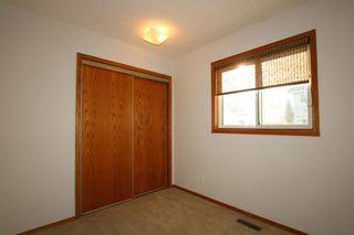 Photo 13: 22 WEST COPITHORNE Place: Cochrane House for sale : MLS®# C4121744