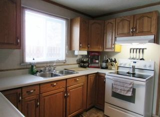 """Photo 9: 12781 OLD HOPE Road: Charlie Lake House for sale in """"CHARLIE LAKE"""" (Fort St. John (Zone 60))  : MLS®# R2043655"""