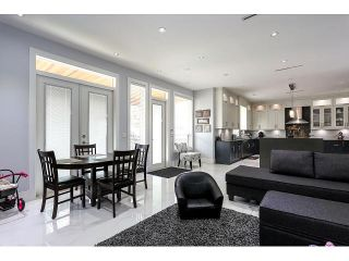 Photo 9: 4038 RUMBLE ST - LISTED BY SUTTON CENTRE REALTY in Burnaby: Suncrest House for sale (Burnaby South)  : MLS®# V1122974