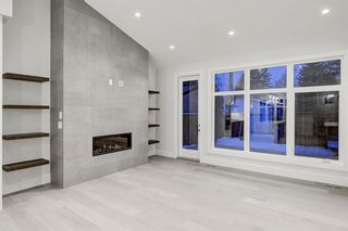 Photo 8: 5911 Lockinvar Road SW in Calgary: Lakeview Detached for sale : MLS®# A1048910