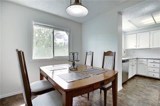 Photo 8: 24 GLAMIS Gardens SW in Calgary: Glamorgan Row/Townhouse for sale : MLS®# A1077235