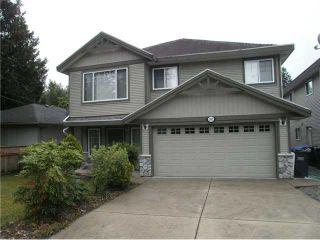 Photo 1: 2402 KITCHENER AV in Port Coquitlam: Woodland Acres PQ House for sale : MLS®# V1126516