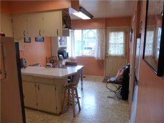 Photo 6: 6806 DOMAN Street in Vancouver: Killarney VE House for sale (Vancouver East)  : MLS®# V1138424