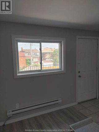 Photo 5: 900 ELSMERE Unit# A in Windsor: House for lease : MLS®# 21002807