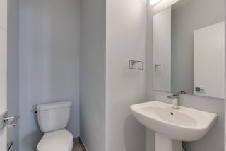 Photo 8: 104 1616 24th Ave NW in Calgary: Capitol Hill Row/Townhouse for sale : MLS®# A1104099