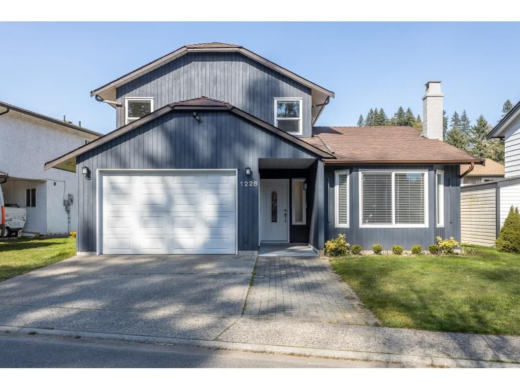 """Main Photo: 1228 RIVER Drive in Coquitlam: River Springs House for sale in """"RIVER SPRINGS"""" : MLS®# R2449831"""