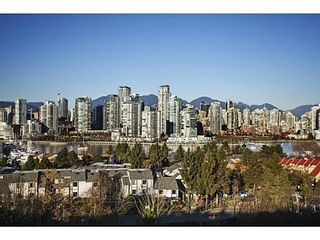Photo 1: 107 1141 7TH Ave W in Vancouver West: Home for sale : MLS®# V1038154