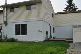 Photo 1: 4305 5 Avenue SE in Calgary: Forest Heights Row/Townhouse for sale : MLS®# A1129865