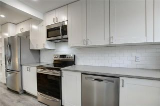 Photo 11: 18 23 GLAMIS Drive SW in Calgary: Glamorgan Row/Townhouse for sale : MLS®# C4293162