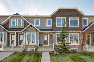 Photo 1: 113 ASPEN HILLS Drive SW in Calgary: Aspen Woods Row/Townhouse for sale : MLS®# A1057562