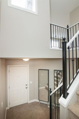 Photo 7: 108 BRIDLECREST Street SW in Calgary: Bridlewood Detached for sale : MLS®# C4203400