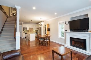 """Photo 4: 101 3333 DEWDNEY TRUNK Road in Port Moody: Port Moody Centre Townhouse for sale in """"CENTREPOINT"""" : MLS®# R2378597"""