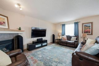 Photo 4: 55 Cougar Ridge Court SW in Calgary: Cougar Ridge Detached for sale : MLS®# A1110903