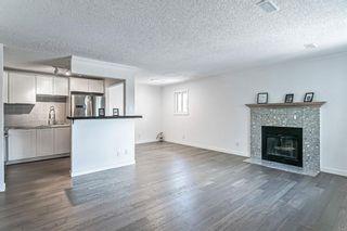 Photo 5: 15 Cedar Spring Gardens SW in Calgary: Cedarbrae Row/Townhouse for sale : MLS®# A1103133