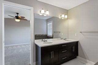 Photo 28: 144 Heritage Boulevard: Cochrane Detached for sale : MLS®# A1125296