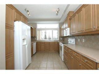 Photo 12: 191 CRAWFORD Drive: Cochrane Condo for sale : MLS®# C4103820