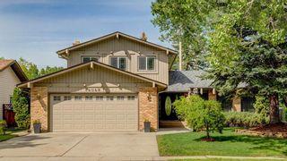 Photo 1: 14048 PARKLAND Boulevard SE in Calgary: Parkland Detached for sale : MLS®# A1018144