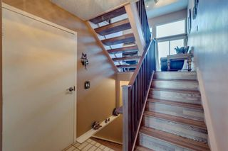 Photo 5: 39 185 Woodridge Drive SW in Calgary: Woodlands Row/Townhouse for sale : MLS®# A1069309