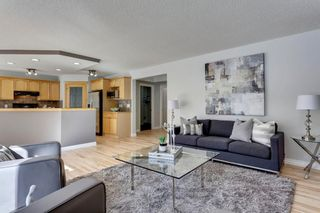 Photo 1: 12469 Crestmont Boulevard SW in Calgary: Crestmont Detached for sale : MLS®# A1109219