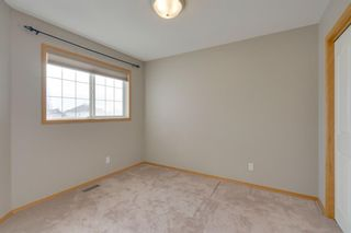Photo 11: 106 Arbour Butte Road NW in Calgary: Arbour Lake Detached for sale : MLS®# A1075299