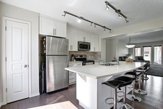 Photo 14: 203 Auburn Meadows Walk SE in Calgary: Auburn Bay Row/Townhouse for sale : MLS®# A1103923
