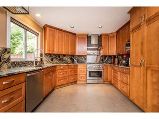 """Photo 6: 8265 148B Street in Surrey: Bear Creek Green Timbers House for sale in """"Shaughnessy Estates"""" : MLS®# R2183721"""