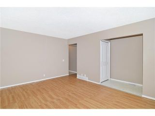 Photo 3: 409 RANCHVIEW Court NW in CALGARY: Ranchlands Residential Attached for sale (Calgary)  : MLS®# C3554095
