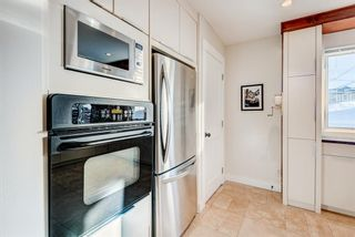 Photo 12: 100 Westwood Drive SW in Calgary: Westgate Detached for sale : MLS®# A1057745
