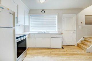 Photo 12: 411 Goddard Avenue NE in Calgary: Greenview Row/Townhouse for sale : MLS®# A1119433