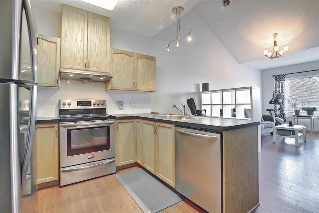 First-time home buyer / investor alert! This spacious top floor 2 BED 2 BATH condo with vaulted ceilings and convenient location off of Deer Foot Trail and close to transit stops  is up for grabs!
