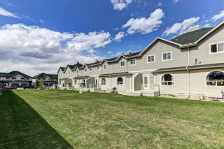 Photo 2: 161 Bayside Point SW: Airdrie Row/Townhouse for sale : MLS®# A1106831