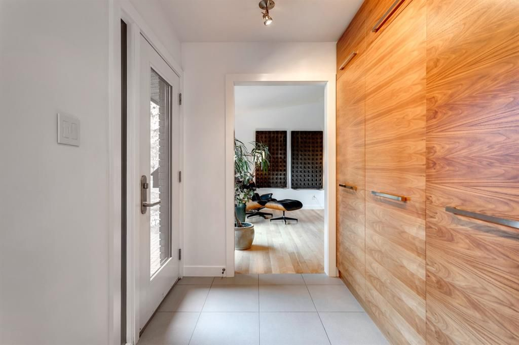 Welcoming entry with custom woodwork