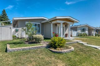 Photo 2: 633 Agate Crescent SE in Calgary: Acadia Detached for sale : MLS®# A1112832