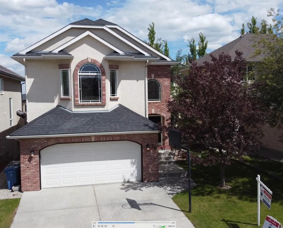 Main Photo: 76 Strathridge Close SW in Calgary: Strathcona Park Detached for sale : MLS®# A1087173