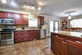 "Photo 8: 5984 MATSQUI Street in Sardis: Vedder S Watson-Promontory House for sale in ""GARRISON CROSSING"" : MLS®# R2302070"