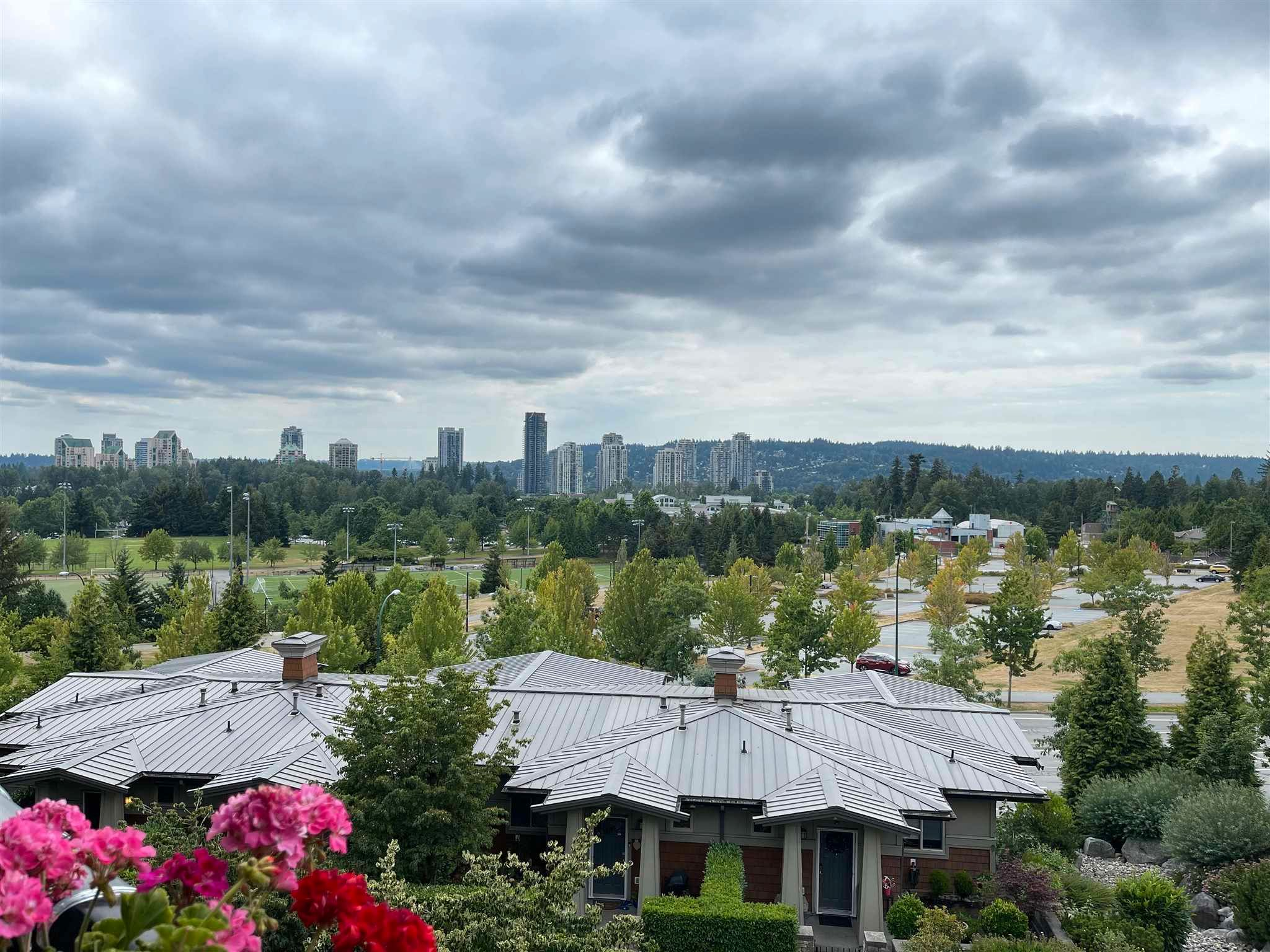 Main Photo: 306 3082 DAYANEE SPRINGS Boulevard in Coquitlam: Westwood Plateau Condo for sale : MLS®# R2601526
