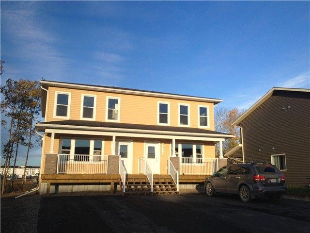 """Main Photo: 8404 88TH Street in Fort St. John: Fort St. John - City SE 1/2 Duplex for sale in """"MATHEWS PARK"""" (Fort St. John (Zone 60))  : MLS®# N240216"""