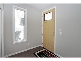 Photo 5: 158 WALGROVE Drive SE in Calgary: Walden House for sale : MLS®# C4075055