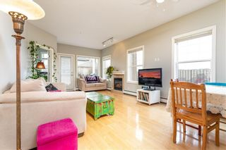 Photo 2: 101 248 SUNTERRA RIDGE Place: Cochrane Apartment for sale : MLS®# C4294936