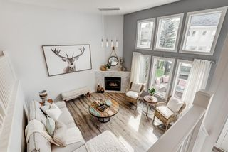 Photo 1: 91 Candle Terrace SW in Calgary: Canyon Meadows Row/Townhouse for sale : MLS®# A1107122