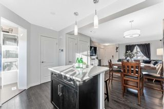 Photo 11: 61 Auburn Meadows View SE in Calgary: Auburn Bay Semi Detached for sale : MLS®# A1081064