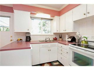 Photo 7: 707 ROBINSON Street in Coquitlam: Coquitlam West House for sale : MLS®# V997474