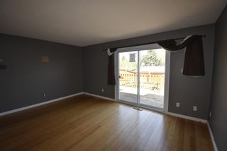 Photo 7: 7 1706 22 Avenue: Didsbury Row/Townhouse for sale : MLS®# A1112062