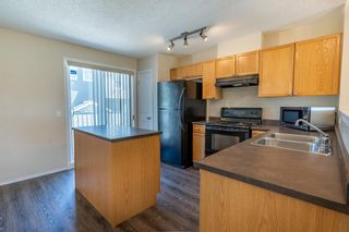 Photo 14: 119 Toscana Gardens NW in Calgary: Tuscany Row/Townhouse for sale : MLS®# A1121039